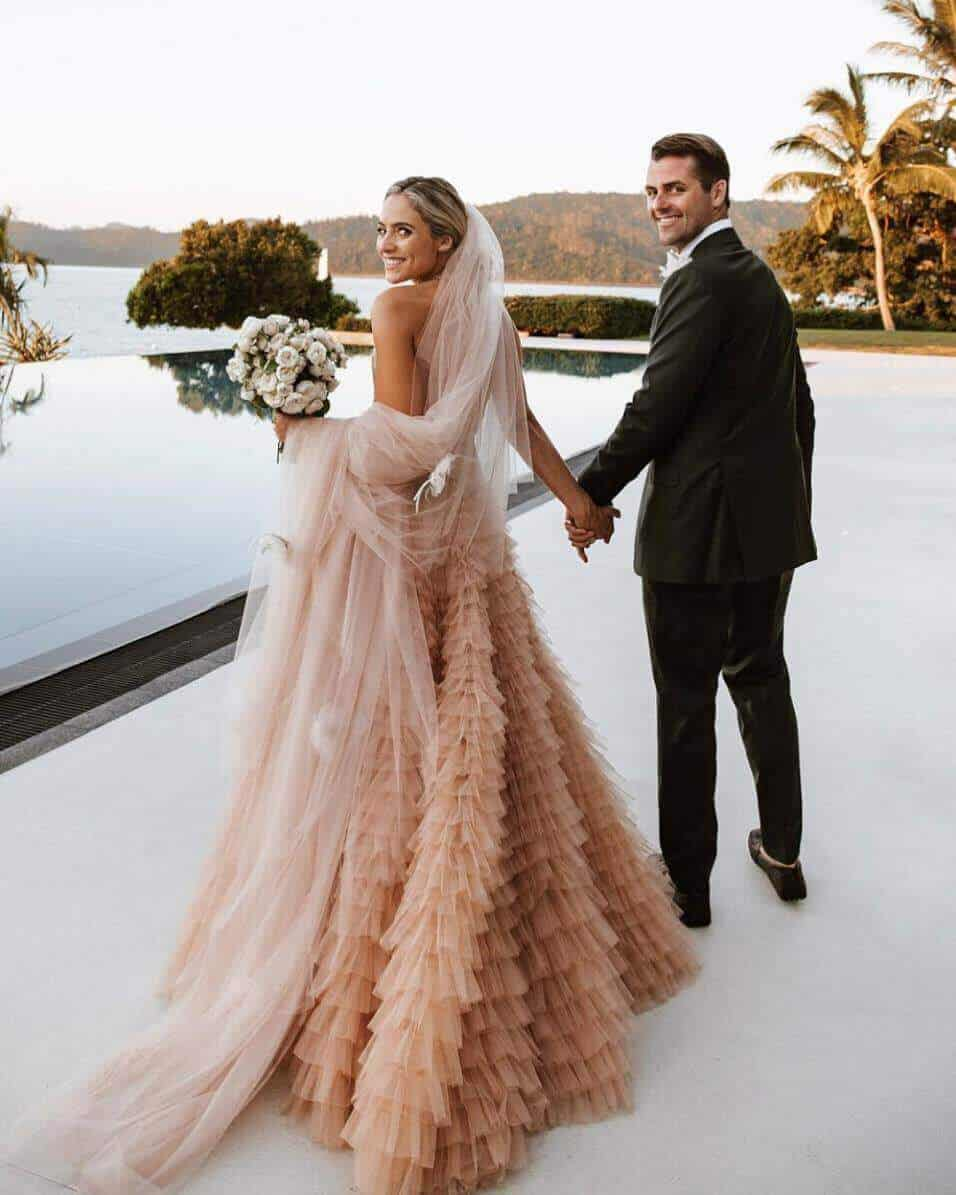The wedding dress pink colour comes in every shape, size and material to match any tradition. You can go for a divine look with a pink and white lace wedding dress, for instance.